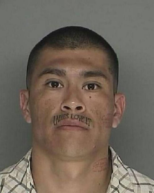 Lip Serviced is listed (or ranked) 13 on the list The Most Out-Of-Control Face Tattoos Captured By The Mugshot Camera