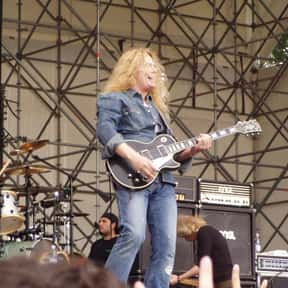 John Sykes is listed (or ranked) 12 on the list Famous Guitarists from England