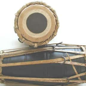 Maadal is listed (or ranked) 17 on the list Drum - Instruments in This Family