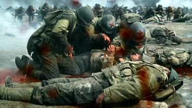 A Medic Brushes Off A Wound In 'Saving Private Ryan'