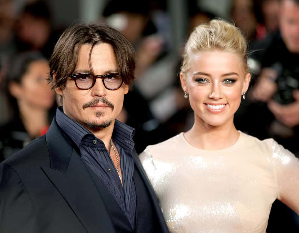 Amber Heard is listed (or ranked) 1 on the list Johnny Depp's Loves & Hookups