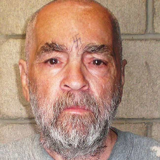 11 creepy tattoos from famous killers for Charles manson tattoos