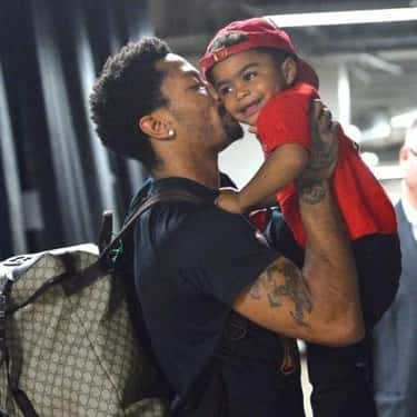 Derrick Rose Sneaks a Kiss is listed (or ranked) 2 on the list Adorable Pictures of NBA Players Caught Being Dads