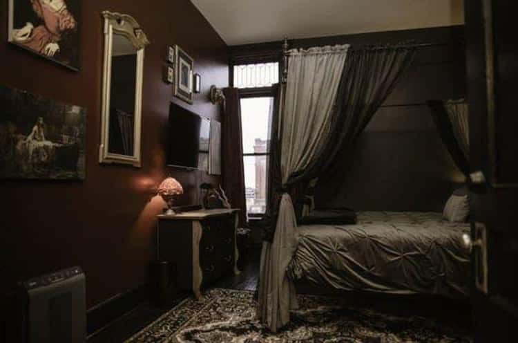 The Countess Bathory Room Features Dark Red Walls And Creepy Taxidermy
