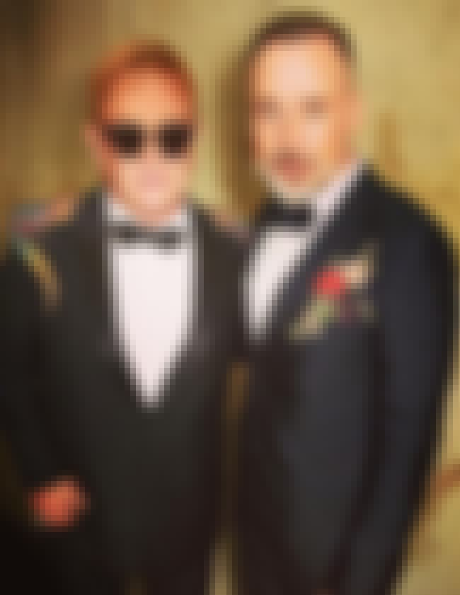 Elton John is listed (or ranked) 4 on the list Gay Celebrities Who Are Married to Same-Sex Partners