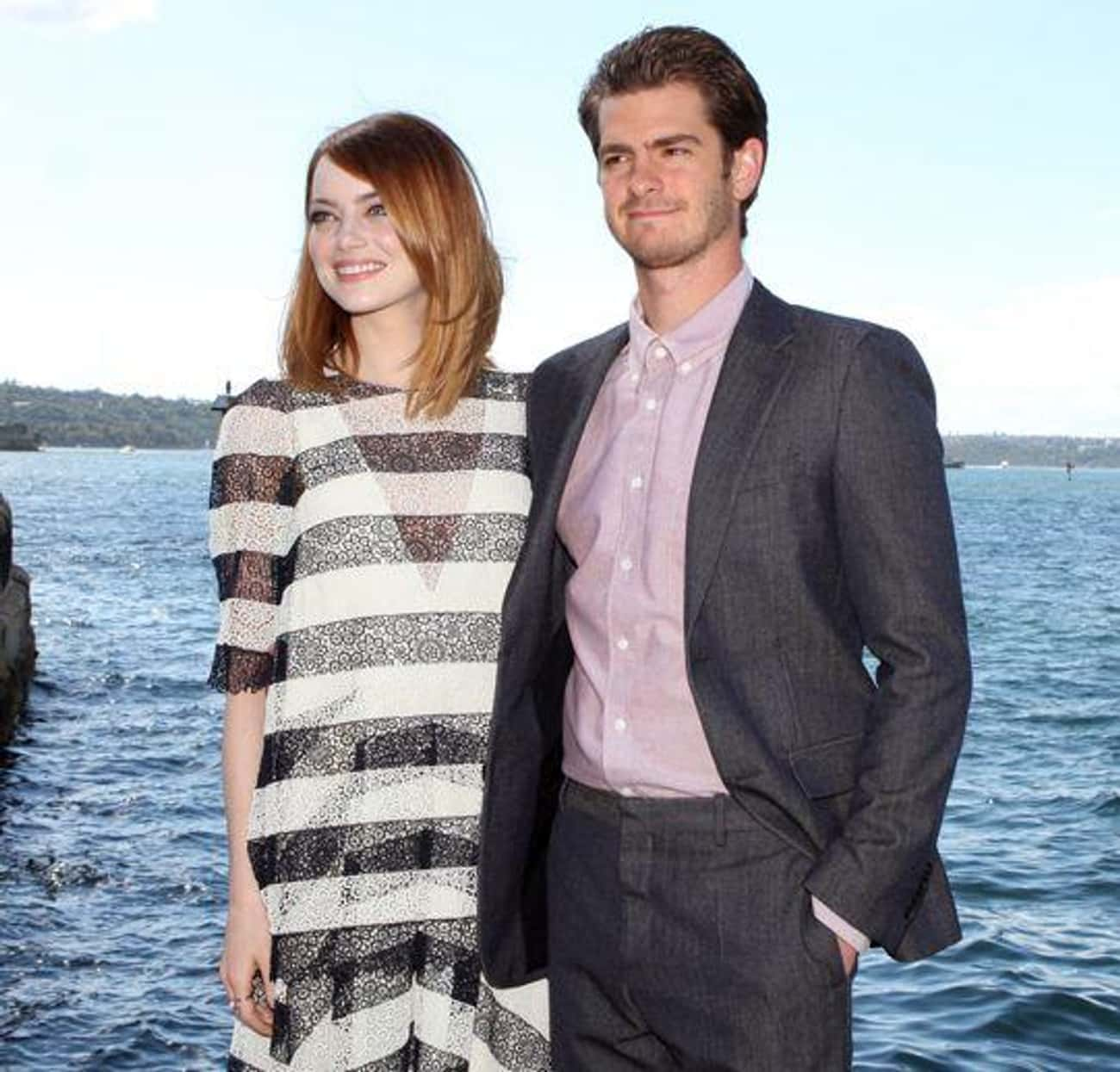 Emma Stone And Andrew Garfield Hold Up Signs Promoting Charities