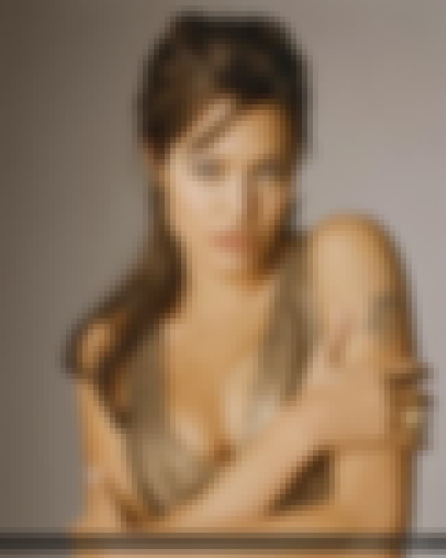 Angelina Jolie is The Girl Wit... is listed (or ranked) 2 on the list The 32 Hottest Angelina Jolie Photos