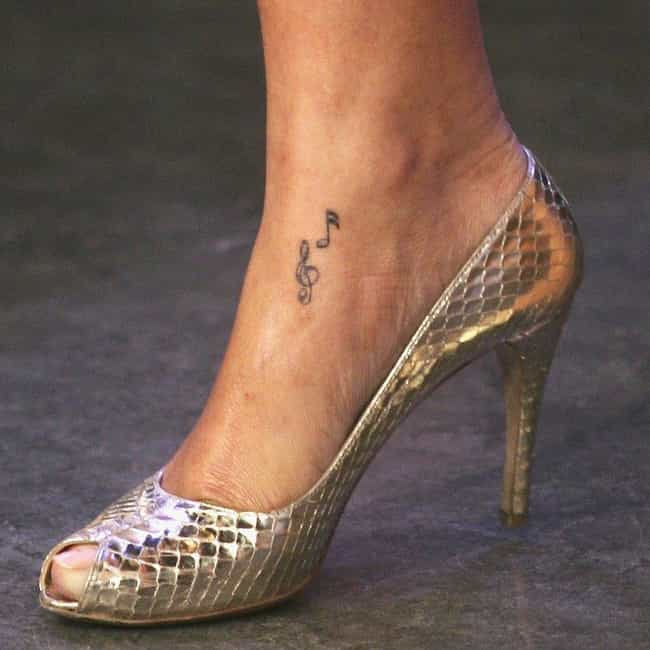 Rihanna's Music Note Tat... is listed (or ranked) 3 on the list Rihanna Tattoos