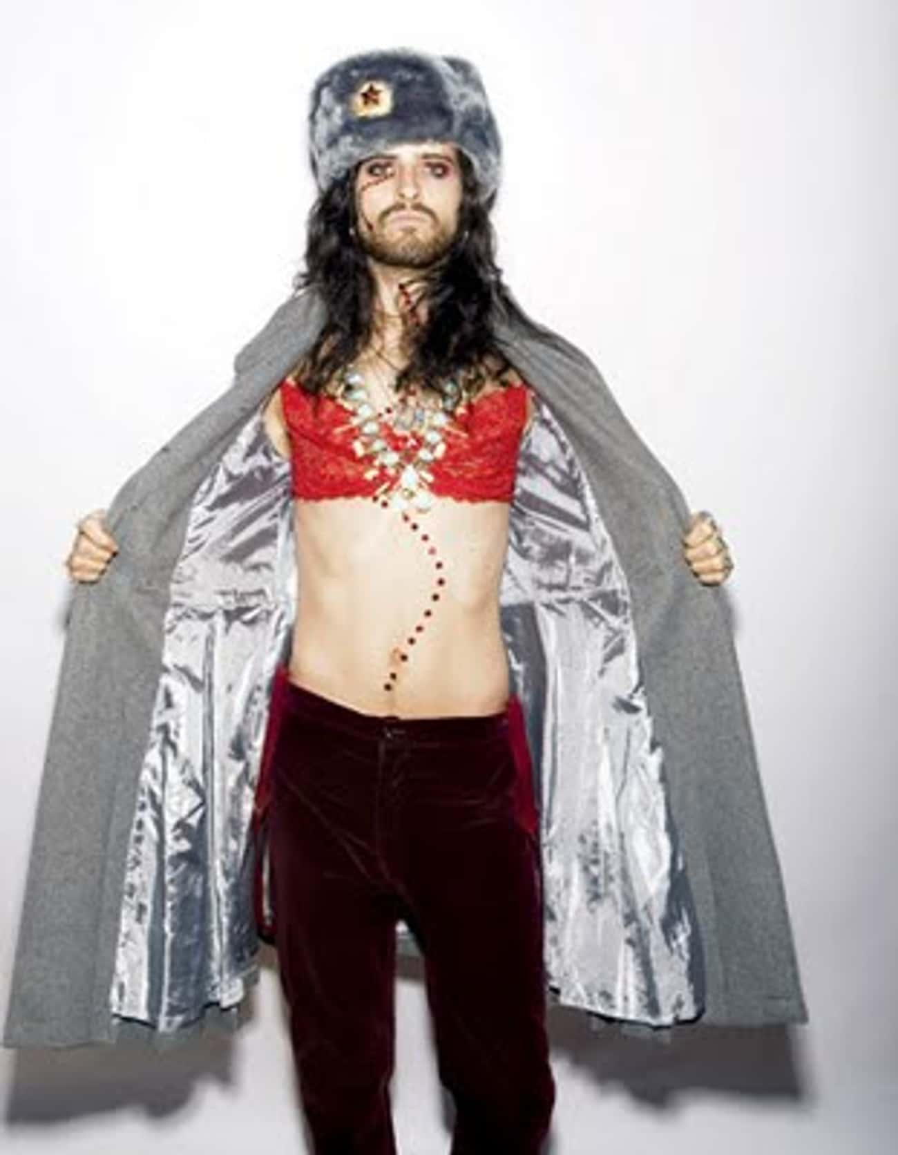 Devendra Banhart in Knit Trench Coat with Satin Insert