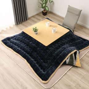 Kotatsu is listed (or ranked) 19 on the list Types of Tables