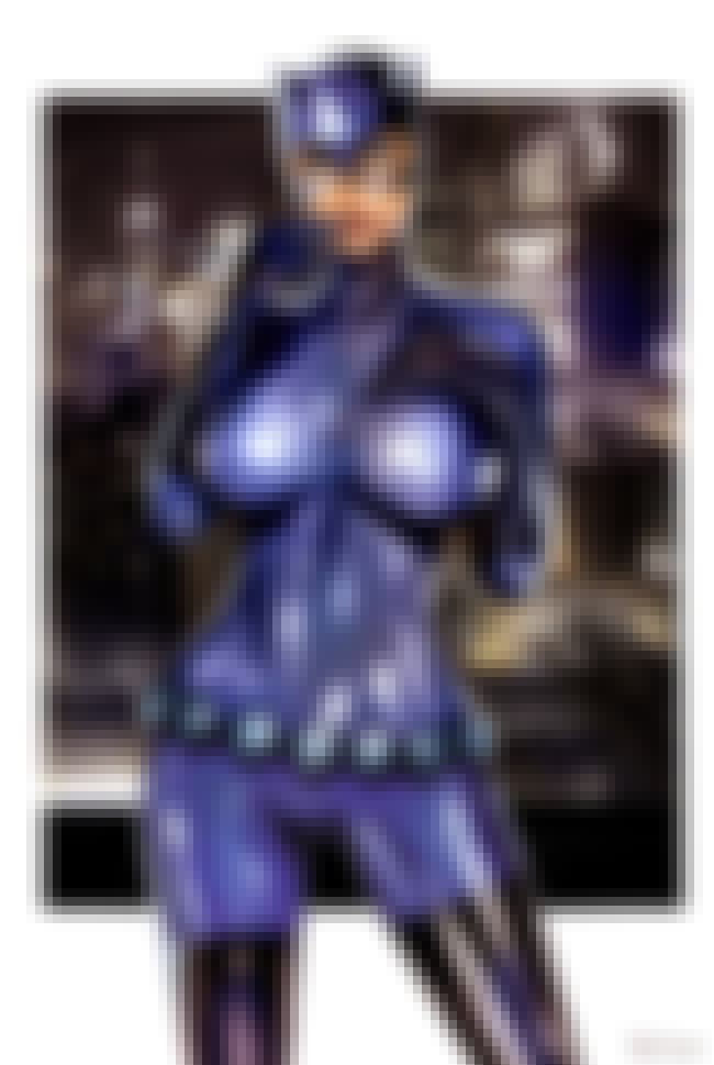 Catwoman in Violet Rubberized ... is listed (or ranked) 1 on the list Sexy Catwoman Pictures