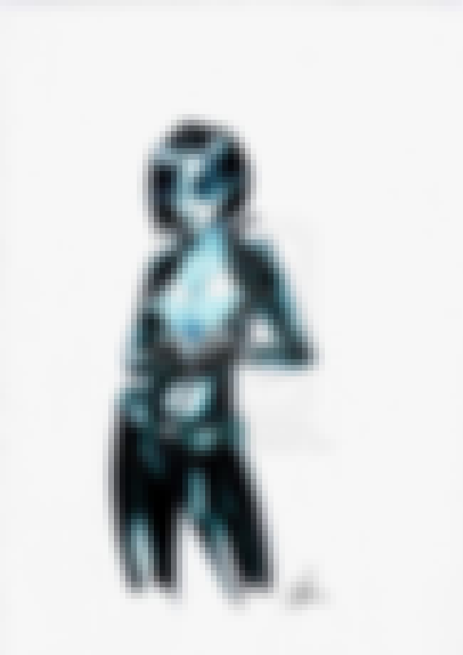 Domino in Deep-Cut Black Suit is listed (or ranked) 2 on the list Sexy Domino Pictures