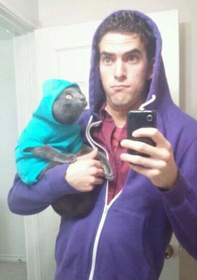 Everybody Wears Hoodies ... is listed (or ranked) 3 on the list The Absolute Worst Pictures of Men Holding Cats