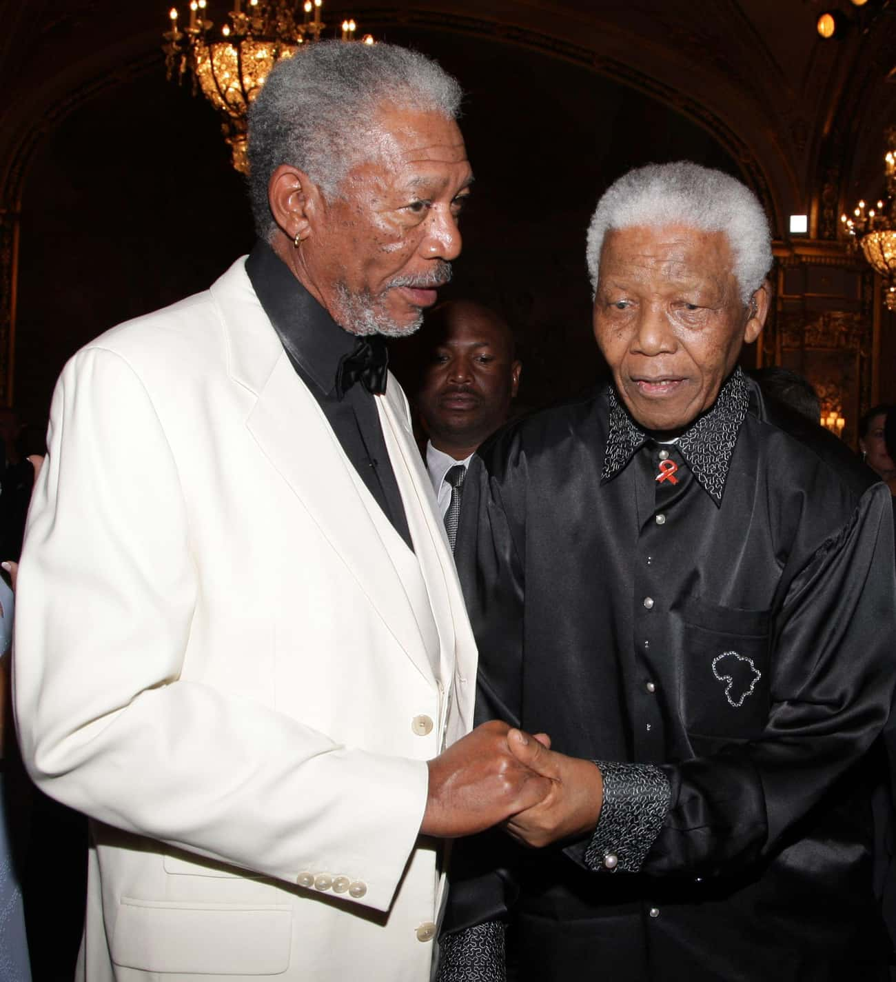 Morgan Freeman and Nelson Mand is listed (or ranked) 1 on the list 23 Awesome Pics Of Actors With People They Played In Movies