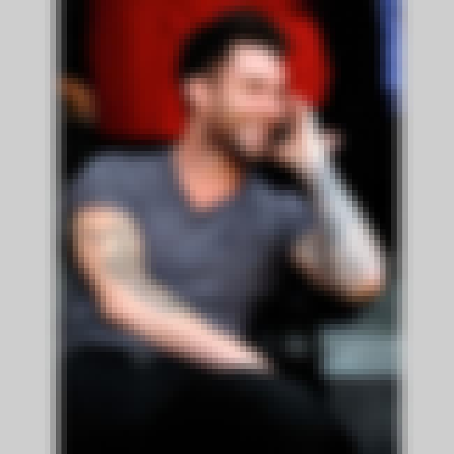 Guitar is listed (or ranked) 4 on the list Adam Levine Tattoos