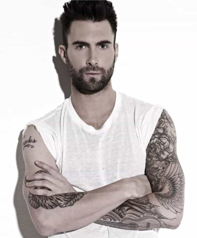 Dove and Cherry Blossoms is listed (or ranked) 1 on the list Adam Levine Tattoos