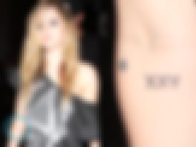 "A Star and ""XXV"" is listed (or ranked) 6 on the list Avril Lavigne Tattoos"
