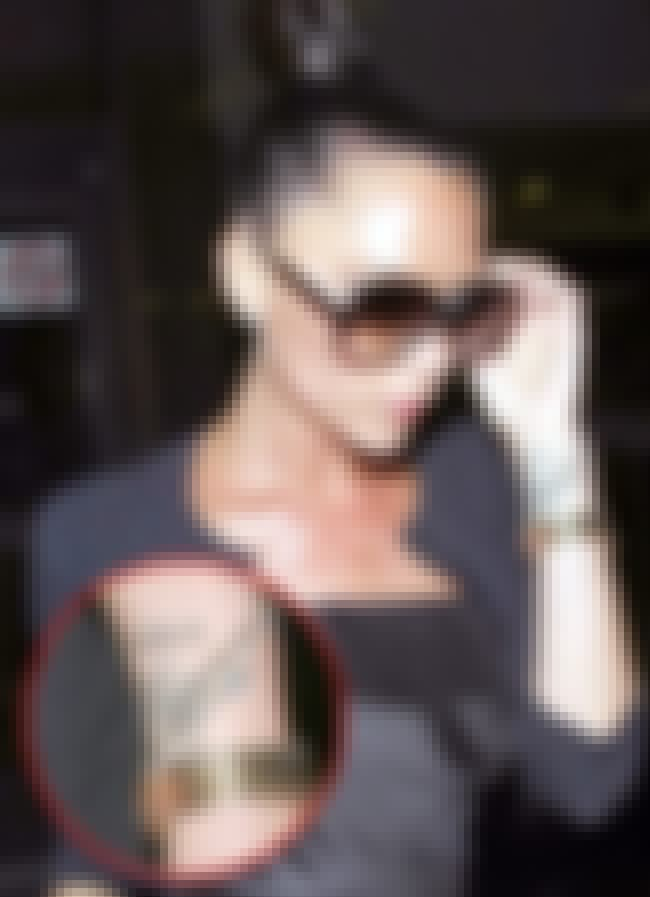 Hebrew Quote is listed (or ranked) 5 on the list Victoria Beckham Tattoos