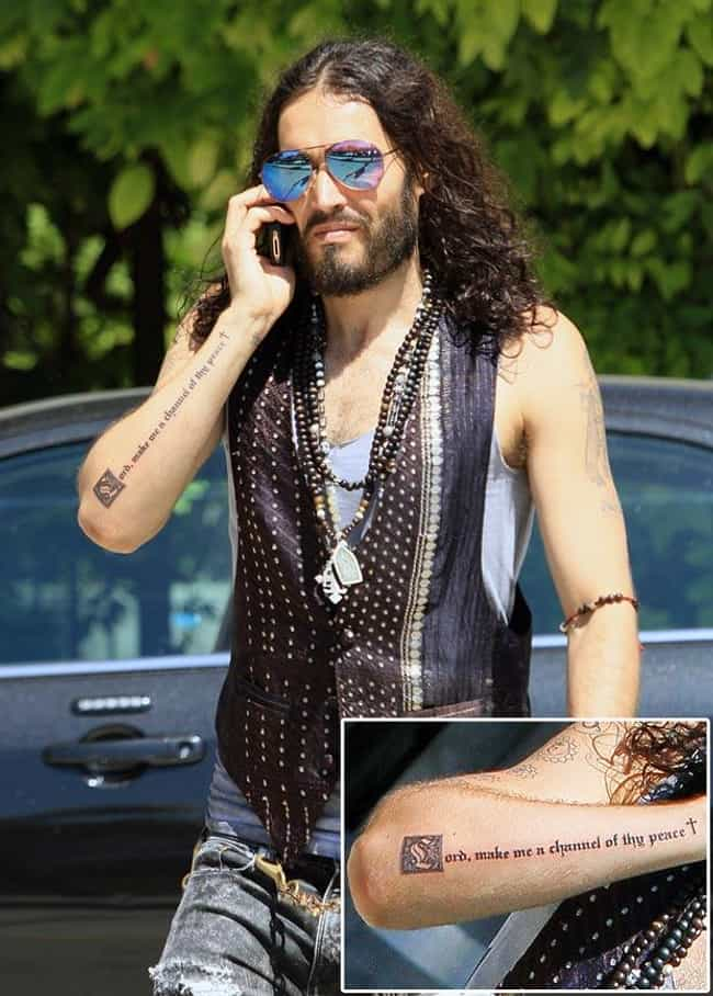 Lord Make Me A Channel o... is listed (or ranked) 1 on the list Russell Brand Tattoos