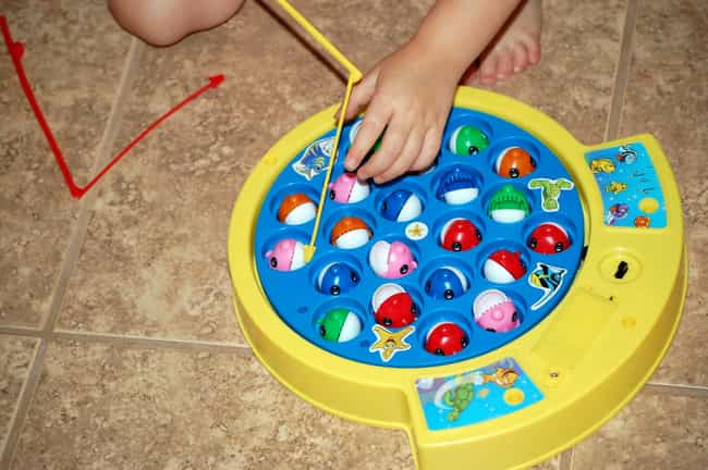 Let's Go Fishin' is listed (or ranked) 3 on the list 23 Annoying Toys That Prove Your Parents Loved You