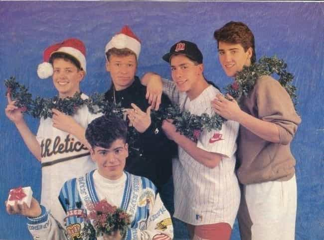 Santa Hats and Holiday D... is listed (or ranked) 3 on the list 34 Cheesiest Boy Band Photos from the 90s