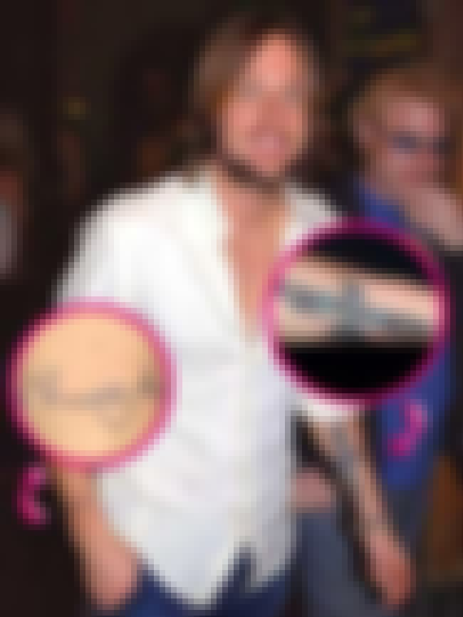 Omnia Vincit Amor is listed (or ranked) 6 on the list Keith Urban Tattoos