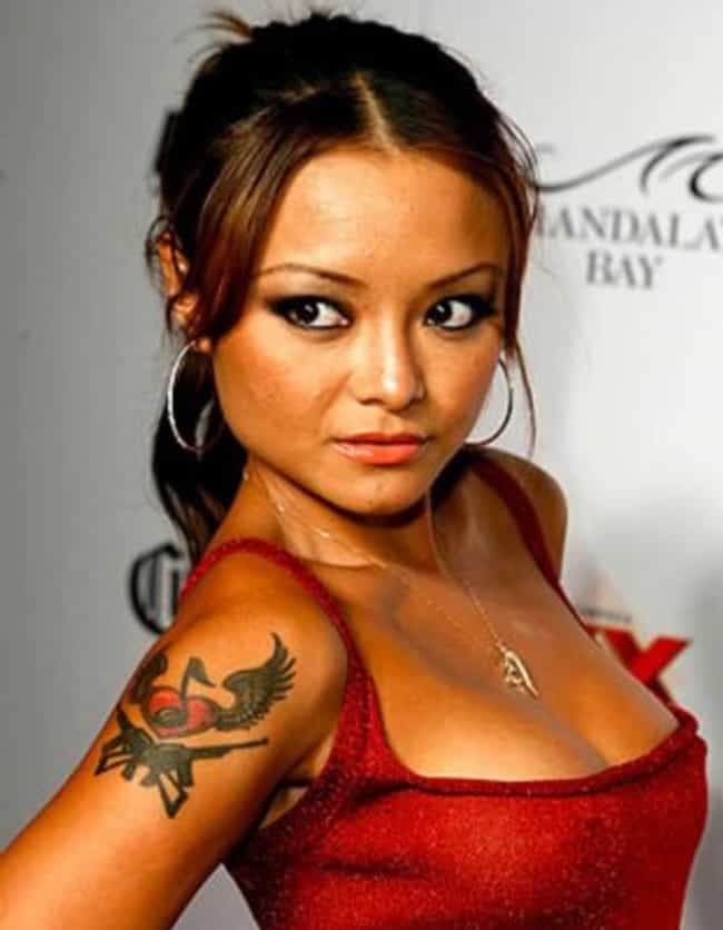 Rifles and Musical Heart... is listed (or ranked) 3 on the list Tila Tequila Tattoos
