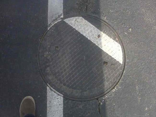 This Manhole Cover is listed (or ranked) 9 on the list Infuriating Images That Will Trigger You