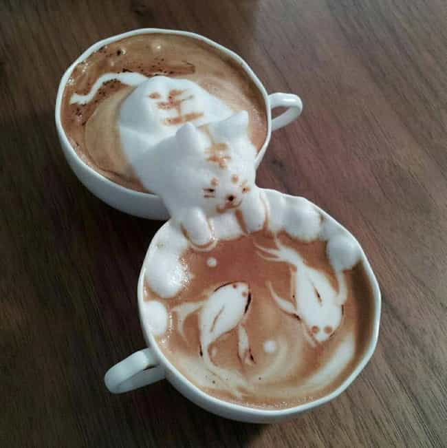 A Cat Reaching Into a Koi Pond is listed (or ranked) 1 on the list 51 Works of Latte Art You'll Never Want to Drink Away