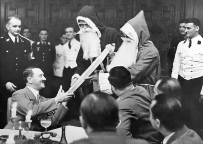 Hitler Getting A Christmas Pre... is listed (or ranked) 5 on the list 15 Infuriating Photos of History's Most Evil People Having The Best Time Ever