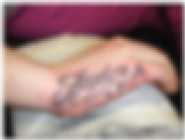 Name Hand Tattoos is listed (or ranked) 7 on the list Hand Tattoos And Designs