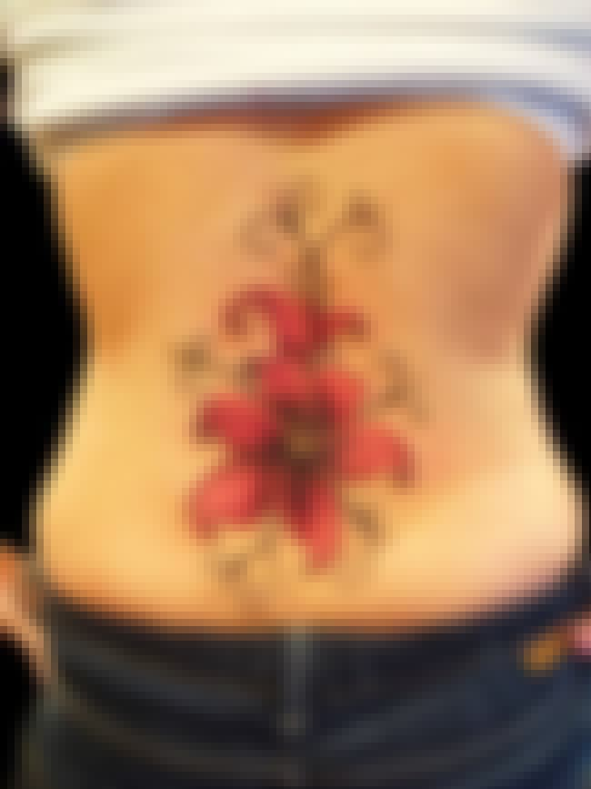 Flower Lower Back Tattoos is listed (or ranked) 2 on the list Lower Back Tattoos And Designs