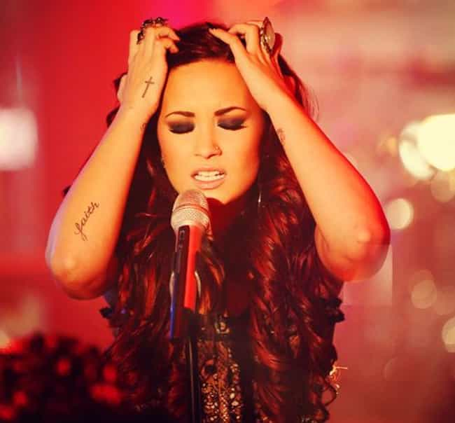 Faith is listed (or ranked) 4 on the list 14 of Demi Lovato's Hottest Tattoos