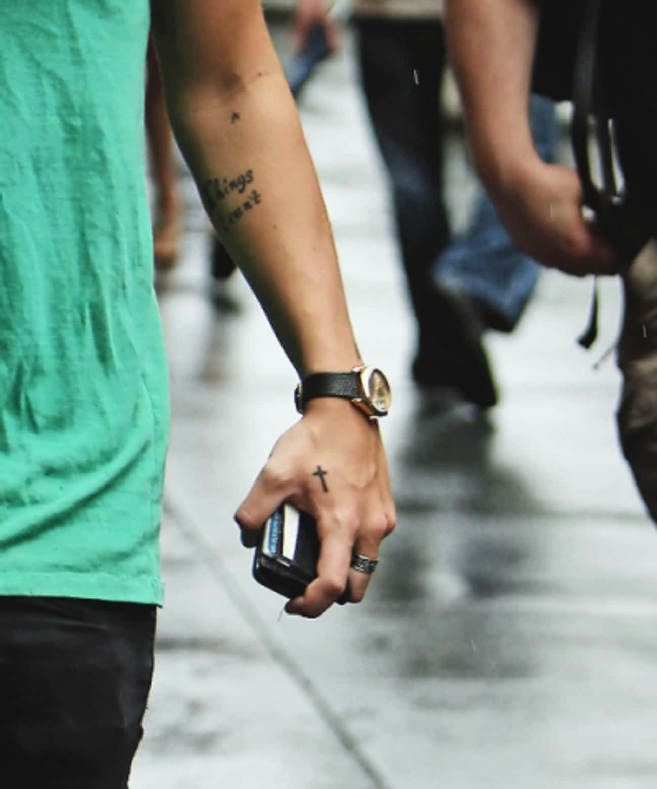 Small Cross Tattoo is listed (or ranked) 4 on the list One Direction's Harry Styles and His (Over 40!) Tattoos