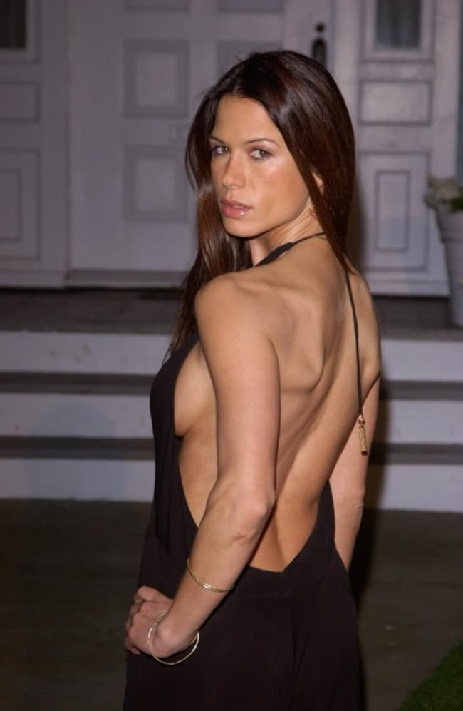 Rhona Mitra In A Backless Dres Is Listed Or Ranked