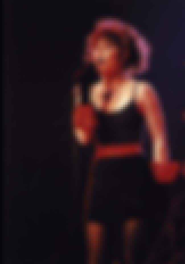 On stage in a black dress is listed (or ranked) 2 on the list The Hottest Pat Benatar Pics