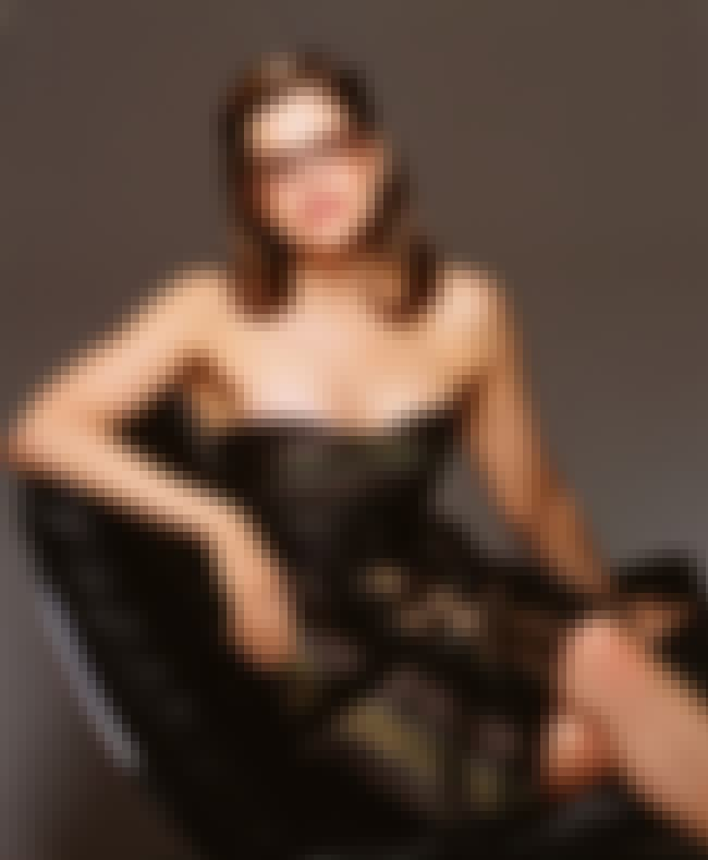 Relaxing in a black chair is listed (or ranked) 2 on the list The Hottest Lisa Loeb Pictures