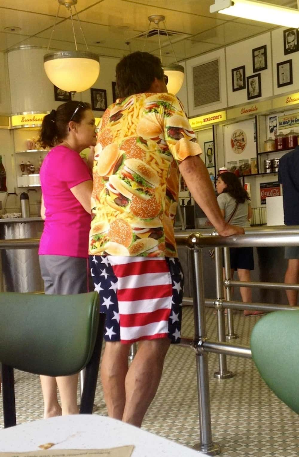 Flags + Burgers=America is listed (or ranked) 1 on the list Terrible 4th of July Outfits That Give America a Bad Name