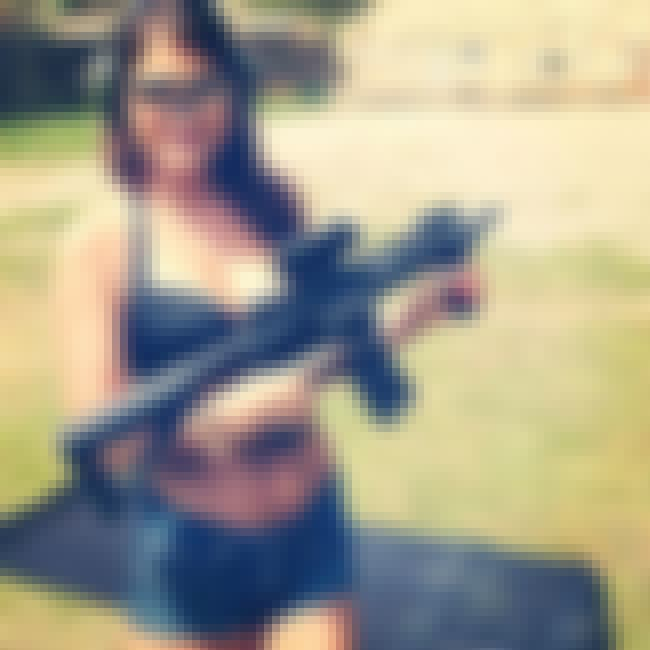 I Don't Know If It's Safer to ... is listed (or ranked) 3 on the list Girls in Bikinis Shooting Guns