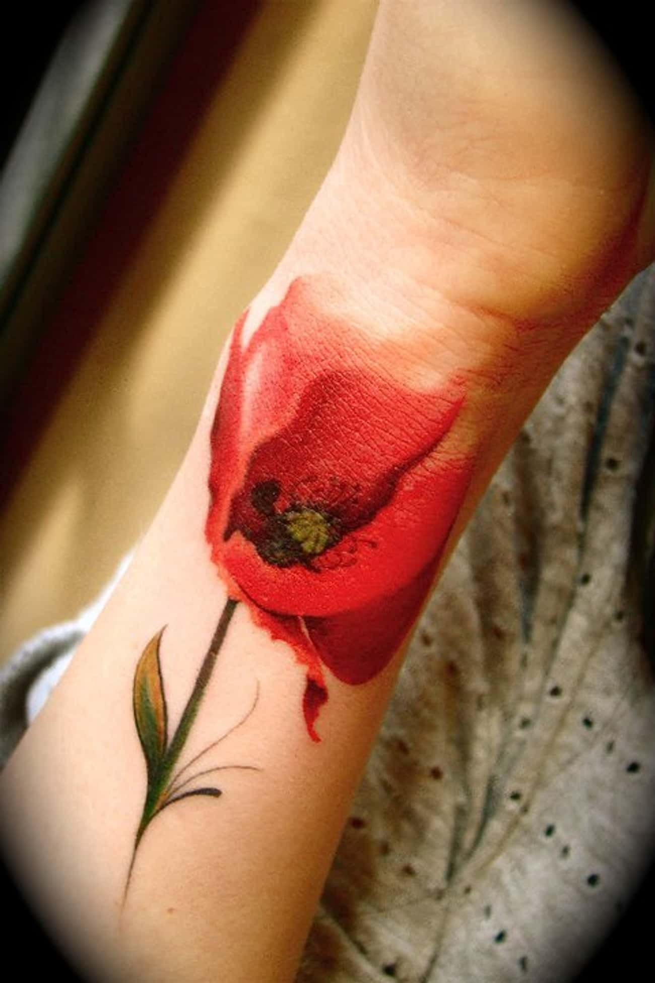 Poppy Tattoo On Wrist is listed (or ranked) 4 on the list Breathtaking Watercolor Tattoos You've Gotta See
