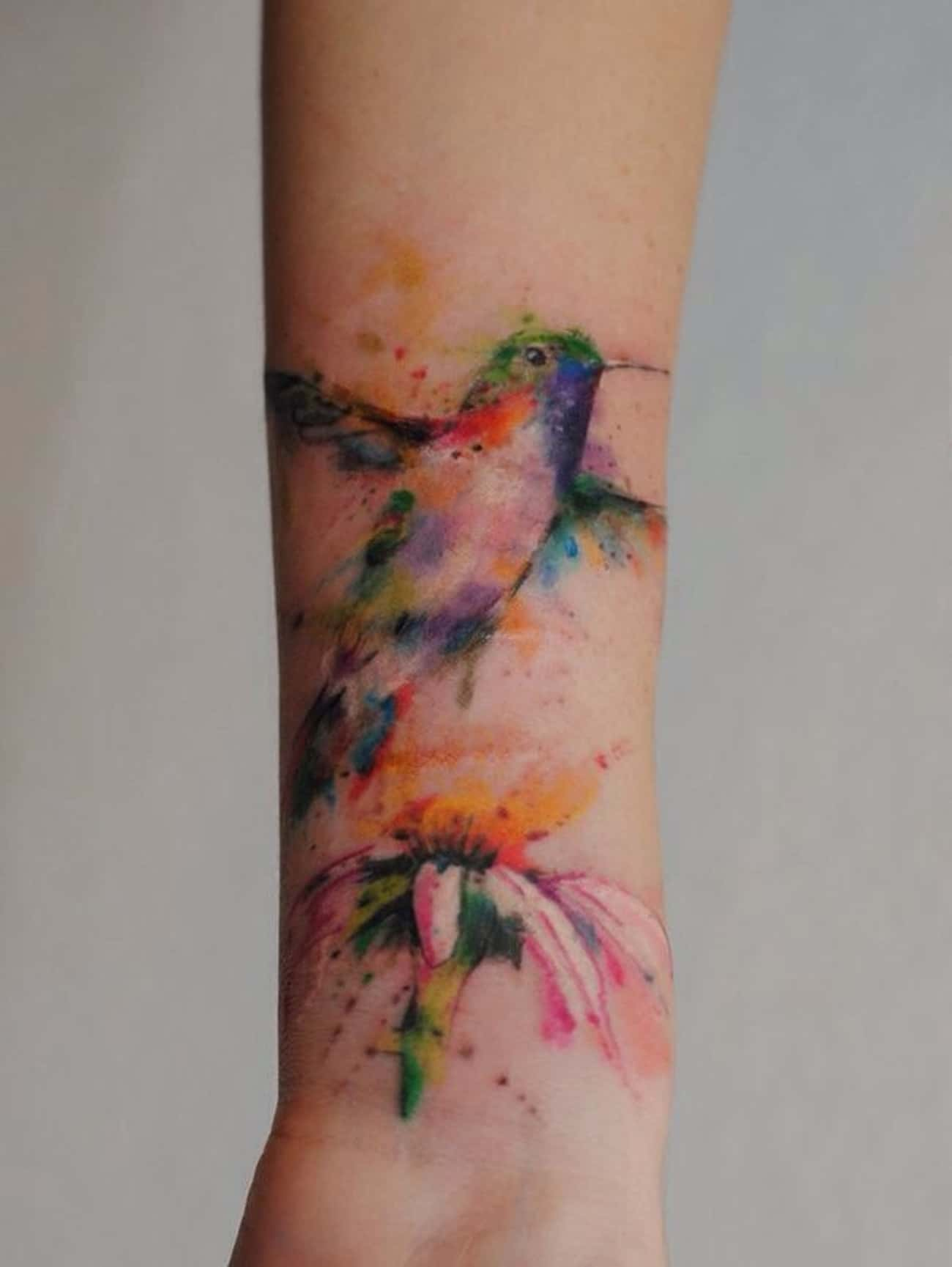 Hummingbird Tattoo On Wrist is listed (or ranked) 1 on the list Breathtaking Watercolor Tattoos You've Gotta See