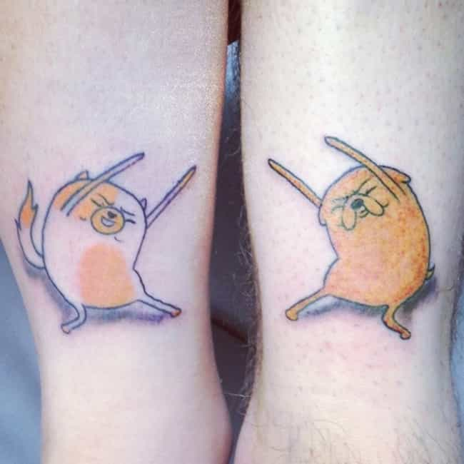 Cake and Jake is listed (or ranked) 3 on the list 100 Awesome Adventure Time Tattoos