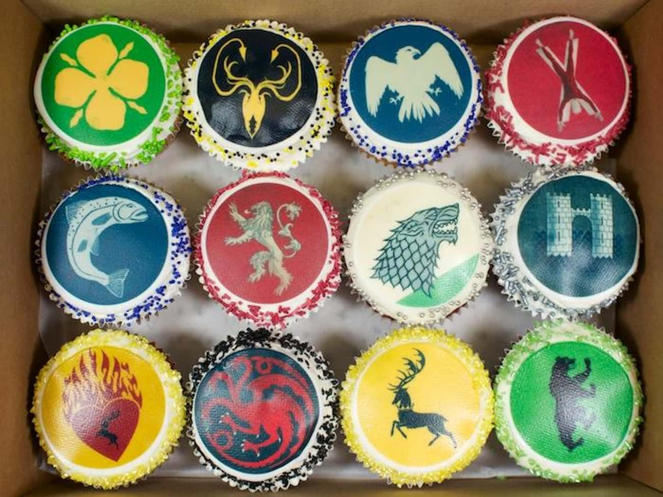 House Sigil Cupcakes is listed (or ranked) 1 on the list 25 Game Of Thrones Cakes Just Waiting To Get Cut