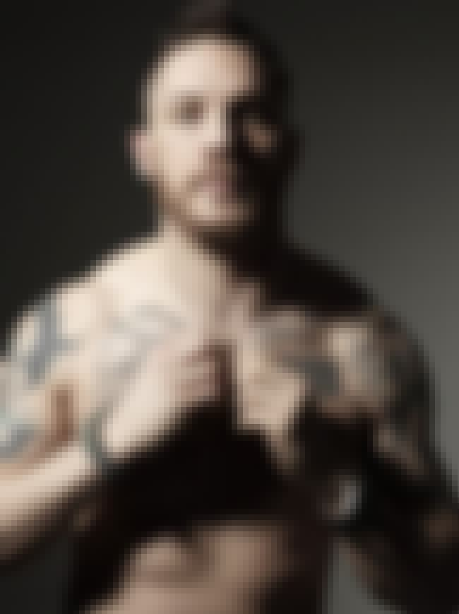 Marine Corps Number is listed (or ranked) 1 on the list 18 of Tom Hardy's Hottest Tattoos