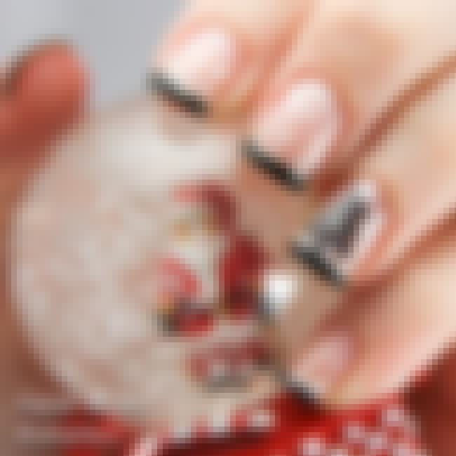 The Stunning Snow Globe is listed (or ranked) 3 on the list 34 Festive Nail Art Designs to Get You in the Holiday Spirit