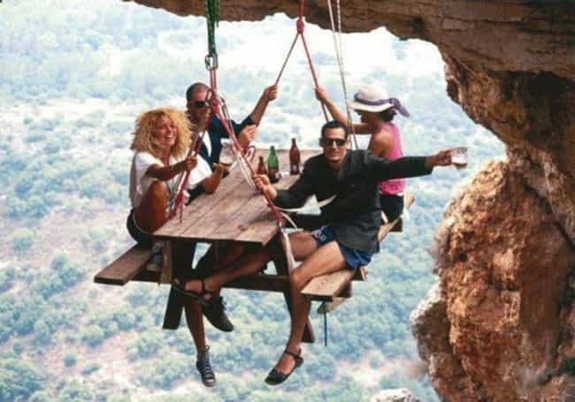 World's Worst Office Potluck is listed (or ranked) 5 on the list Do Not Look at These Photos If You Are Afraid of Heights!
