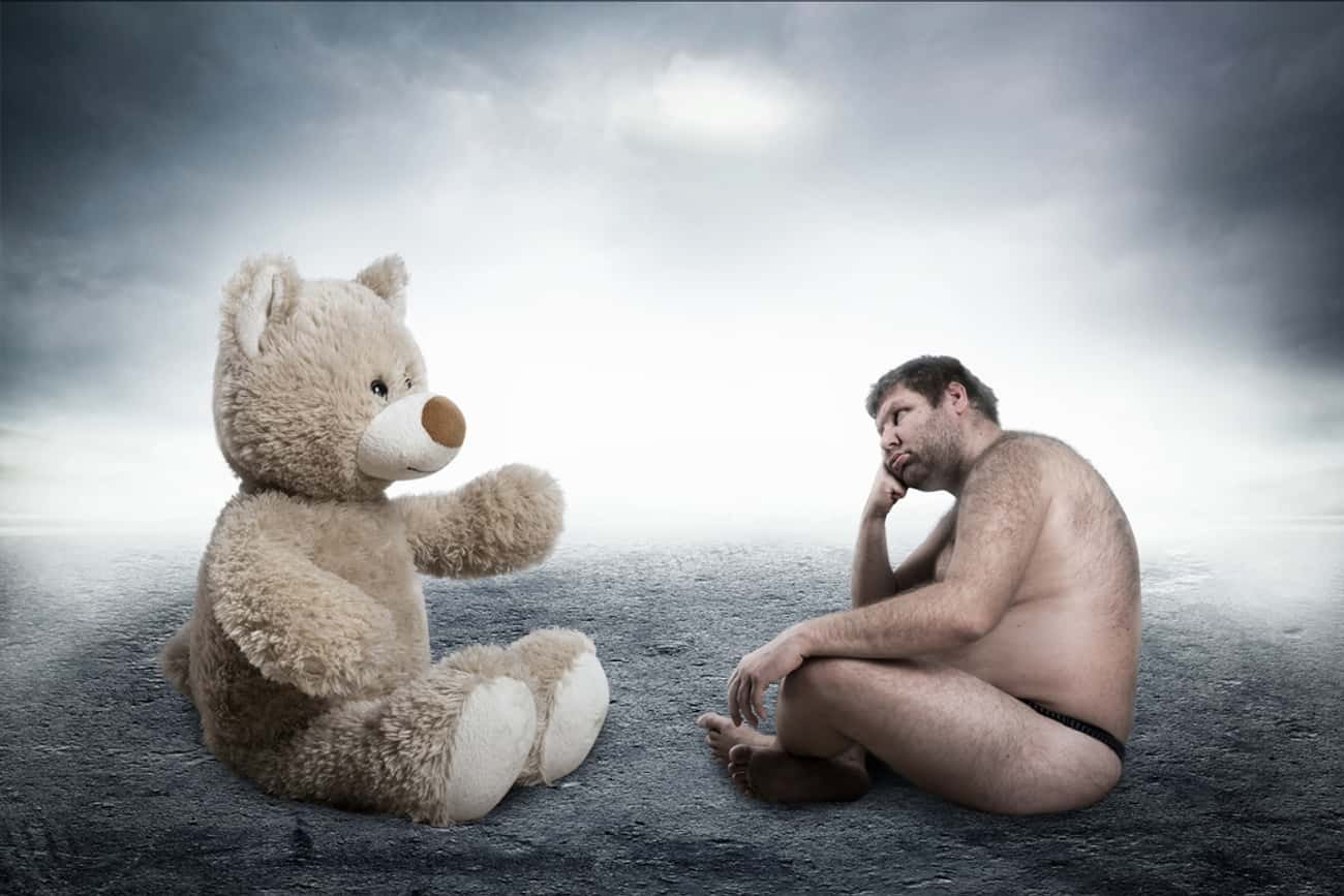 Man Next To Gigantic Teddy Bea is listed (or ranked) 1 on the list The Most Offensively Over-the-Top Stock Images of Fat People