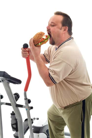 Man Eats Sandwich While Workin is listed (or ranked) 5 on the list The Most Offensively Over-the-Top Stock Images of Fat People