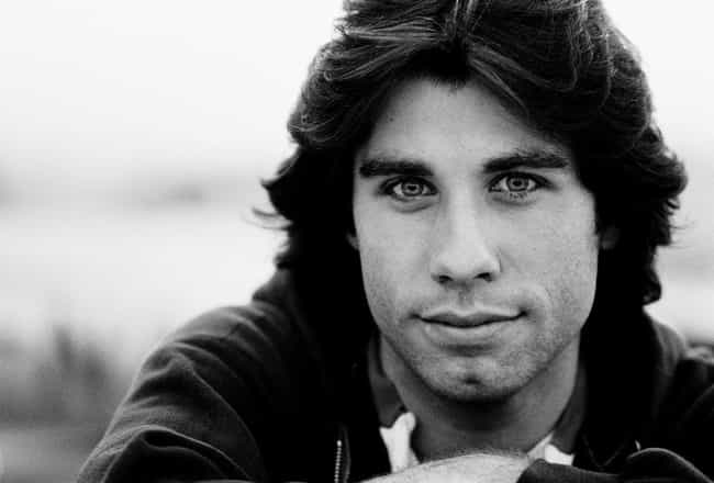 [Image: young-john-travolta-in-black-sweater-clo...crop=faces]