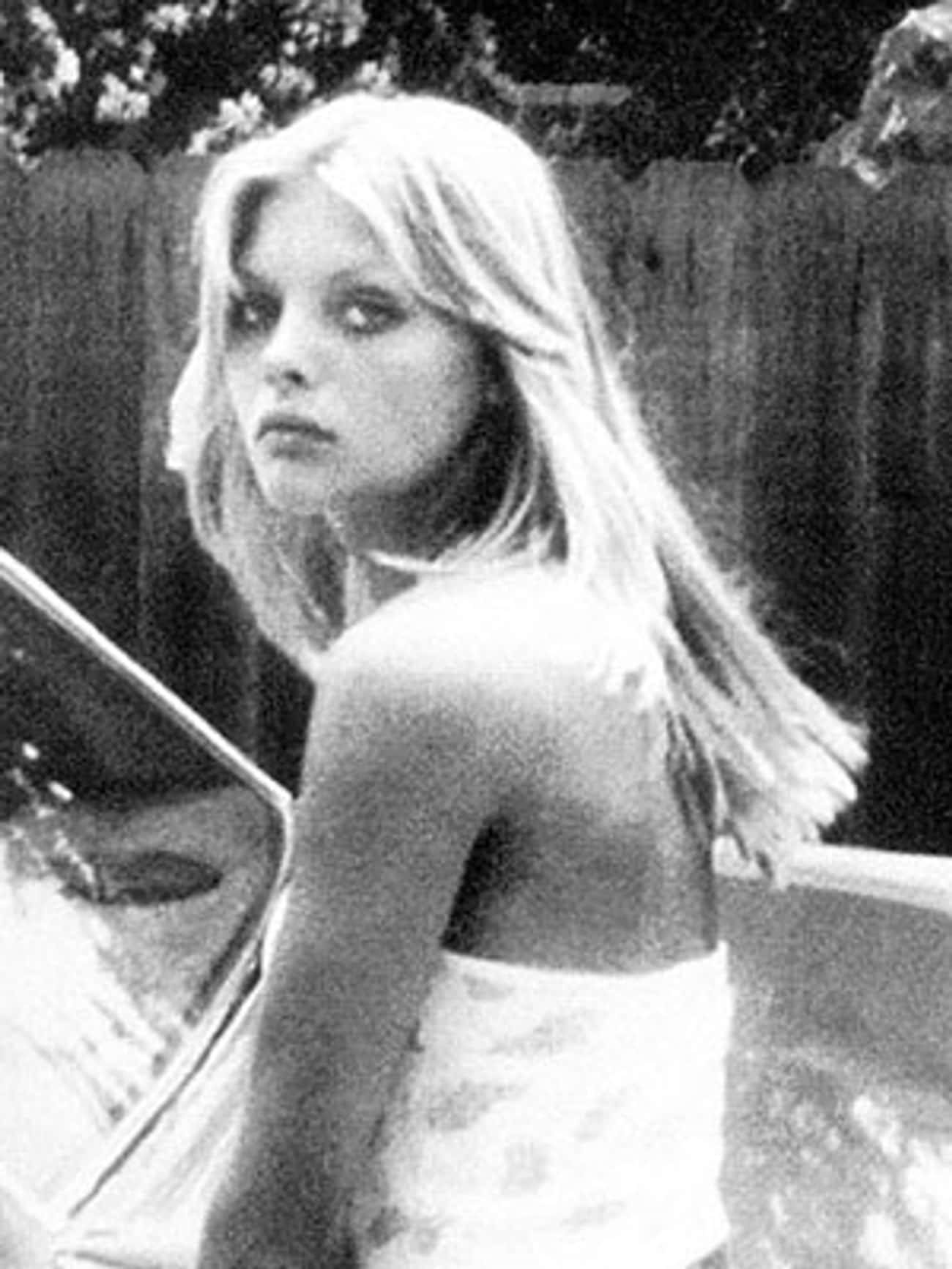Young Michelle Pfeiffer in a White Tank